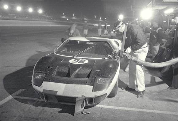 Race winning Ford Mark II driven by Ken Miles/Lloyd Ruby makes a scheduled pit stop