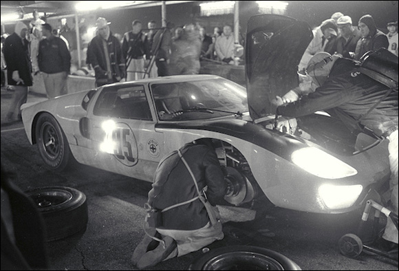 Walt Hansgen/Mark Donohue Ford Mark II makes a pit stop
