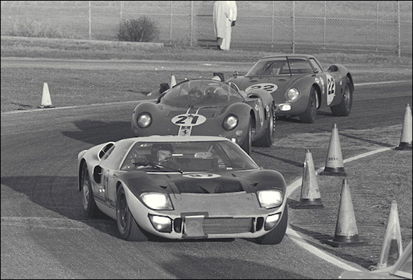 Dan Gurney (#97) in his Ford Mark II leads two Ferraris