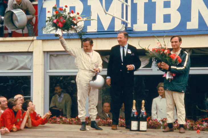 Ford GT Concept HIstory: 24 Hours of LeMans, LeMans, France, 1966. Bruce McLaren (L), HFII and Chris Amon (R) on the victory rostrum.
